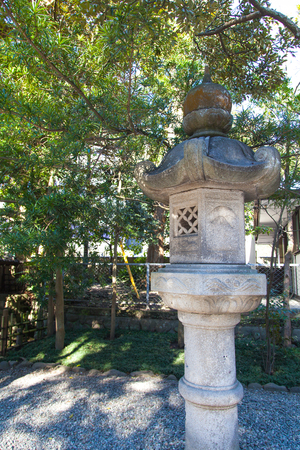 reconstituted: Photo showing a pillar lantern in a landscaped Japanese garden