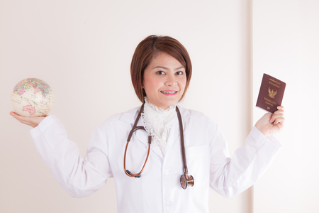 Asian Young  Female doctor ready to travel around the world photo
