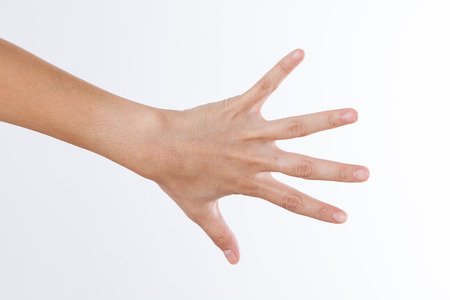 hand showing the five fingers isolated on a white photo
