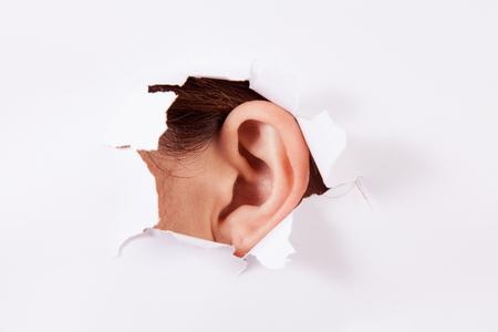 eavesdrop -Spying Bug ear from hole photo