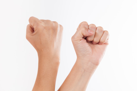 closed fist sign: Arm, hand with a fist, isolated on a white background