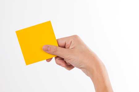 Female hand holding a note  Isolated on a white background  photo