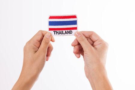 Women Hand Holding Thailand Flag photo