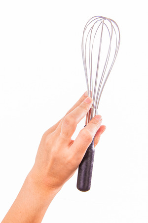 Stainless steel egg whisk in woman hand photo