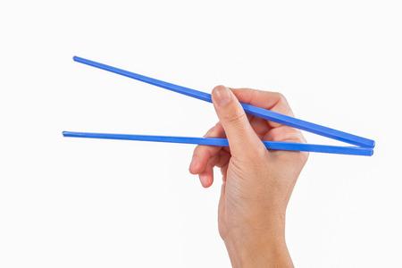 Female Hand Holding colorful Chopsticks photo