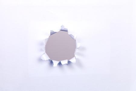 Beige circle shape breakthrough paper hole photo