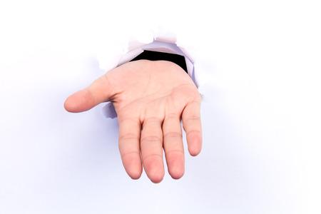 pleading: A young womans hand, palm open.White background. Stock Photo
