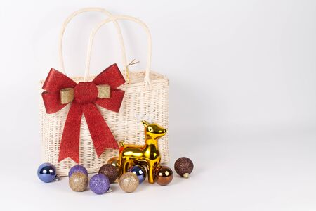 Santa bag with reindeer and colorful ball isolated on white