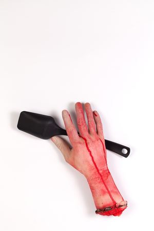 icky: the creepy halloween toy , Zombie Hand with Spoon isolated on white Stock Photo