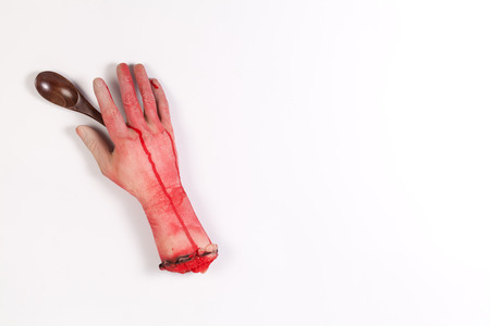 icky: Zombie Hand with Wooden spoon on white background Stock Photo