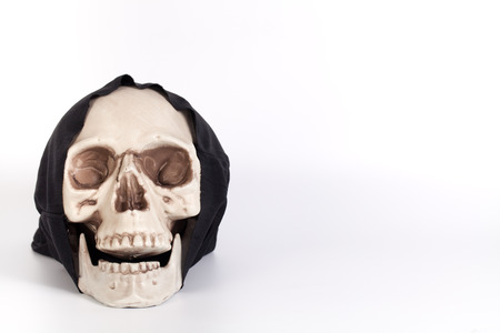 black cap: Human Skull with devil black cap isolated on white