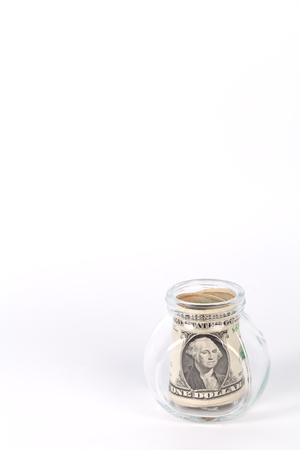 avidity: One dollar bills in a glass jar