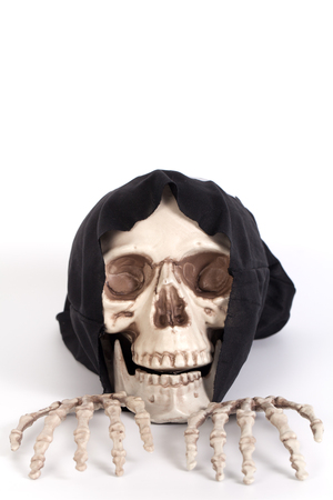 skull cap: Human Skull and Human Hand with devil black cap isolated on white