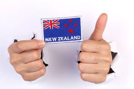 newzealand: Women Hand Holding Newzealand Flag isolated on white