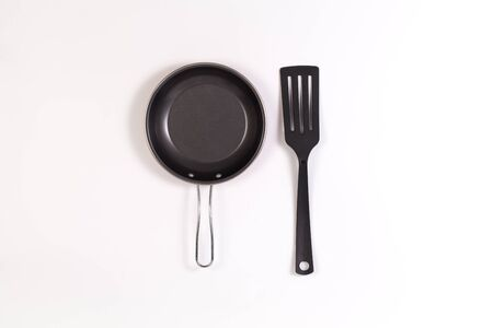 frying pan and spatula with copyspace isolated on white background Stock Photo