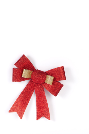 christmas bow: Red and golden Ribbon Bow isolated on White Background.