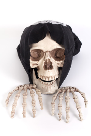 skull cap: Human Skull and Human Hand with devil black cap Stock Photo