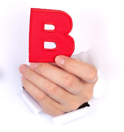letter paper: Women Hand Holding B Alphabet isolated on white