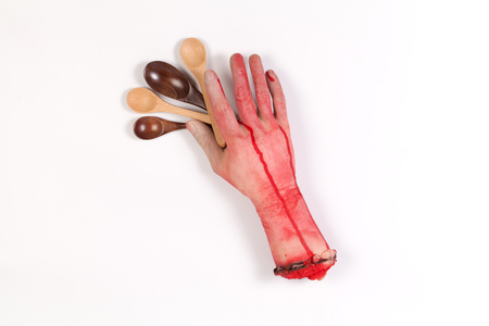 icky: Zombie Hand and wooden Spoon with copyspace