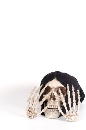 close your eyes: Human Skull Close your eyes with Human Hand and devil black cap