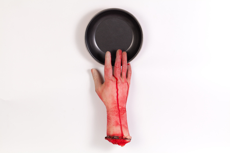 icky: the creepy halloween toy , Zombie Hand with Pan isolated on white Stock Photo