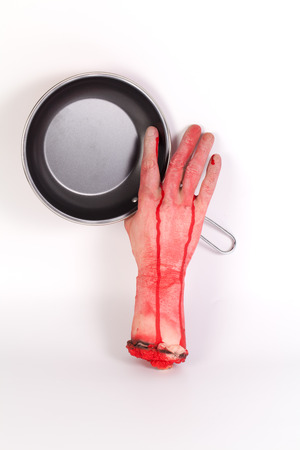 creepy hand: the creepy halloween toy , Zombie Hand with Pan isolated on white Stock Photo