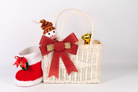 Santa bag with snowman and reindeer isolated on white
