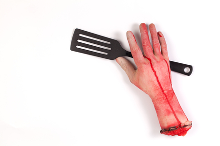 creepy hand: the creepy halloween toy , Zombie Hand with   Spatula isolated on white Stock Photo