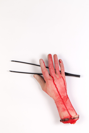 icky: Zombie Hand with Black cooking tongs on white background Stock Photo