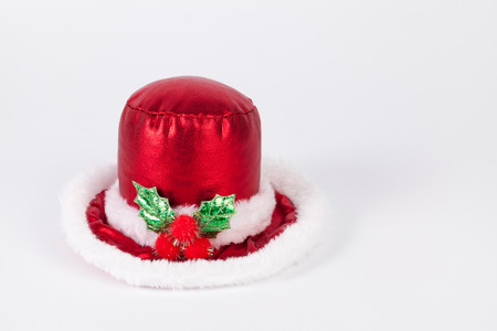 red hat: Single Santa Claus red hat for decoration with copy space isolated on white background