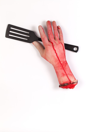 icky: the creepy halloween toy , Zombie Hand with   Spatula isolated on white Stock Photo