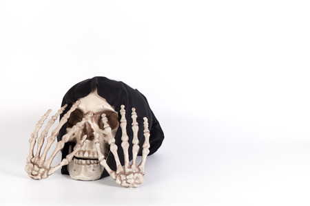 skull cap: Human Skull Close your eyes with Human Hand and devil black cap isolated on white