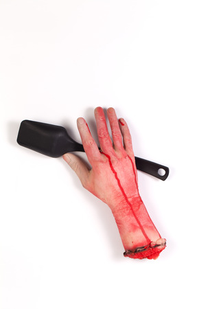creepy hand: the creepy halloween toy , Zombie Hand with Spoon isolated on white Stock Photo