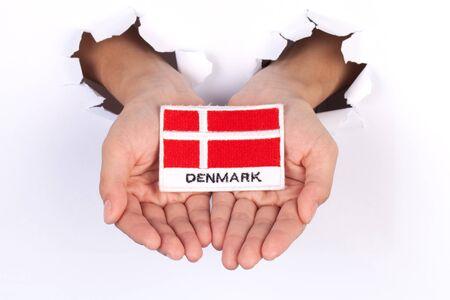 denmark flag: Women Hand Holding Denmark Flag isolated on white