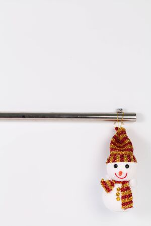 steel pipe: Hanging christmas snowman with old  steel pipe isolated on white background