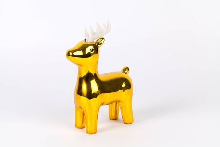 shiny gold: Shiny gold reindeer ornament with copy space, on white.