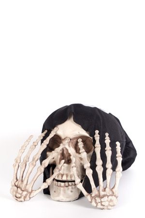 close your eyes: Human Skull Close your eyes with Human Hand and devil black cap isolated on white