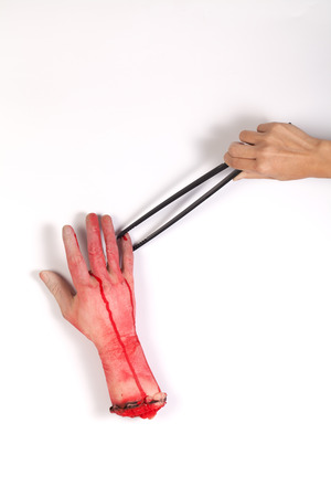 zombie hand: Zombie Hand with Tongs Stock Photo