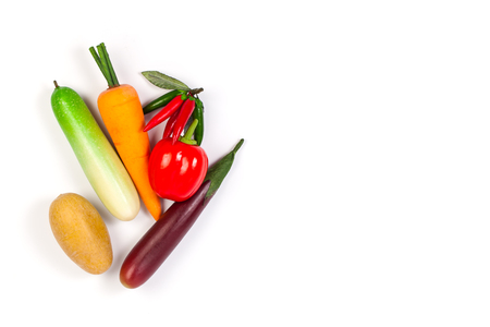 faked: Close up of fake cucumber,Purple Eggplant ,potato , chilli, carrot and bell pepper. Isolated on a white background