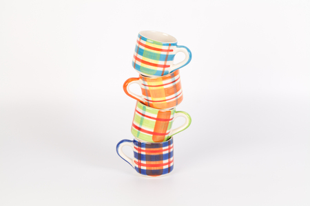 chequer: Tower of Colorful Scotch pattern cups Stock Photo