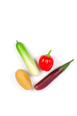 faked: Cucumber ,Purple Eggplant ,potato and bell pepper isolated on white background