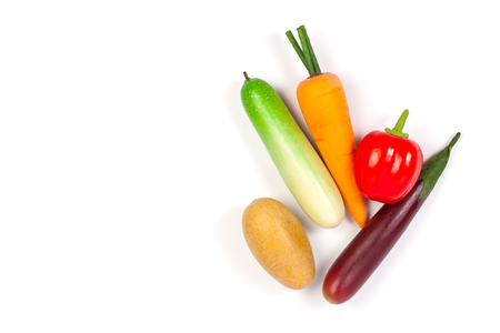 faked: Close up of fake cucumber,Purple Eggplant ,potato , carrot and bell pepper. Isolated on a white background