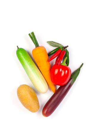 cuke: Close up of fake cucumber,Purple Eggplant ,potato , chilli, carrot and bell pepper. Isolated on a white background