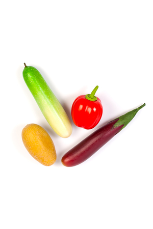 cuke: Close up of fake cucumber,Purple Eggplant ,potato , carrot and bell pepper. Isolated on a white background