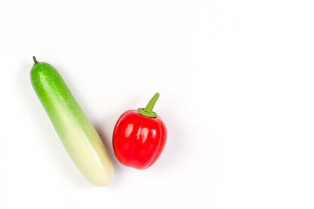 faked: Close up of fake cucumber and bell pepper. Isolated on a white background