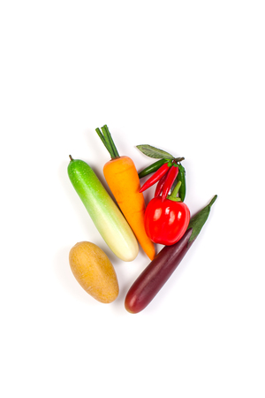 Close up of fake cucumber,Purple Eggplant ,potato , chilli, carrot and bell pepper. Isolated on a white background