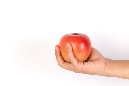 Hand holding red apple. Isolated on a white background Imagens