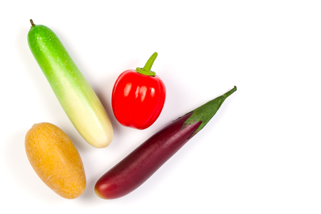 cuke: Close up of fake cucumber,Purple Eggplant ,potato and bell pepper. Isolated on a white background