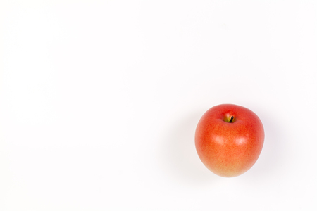 Fake red apple on a white background