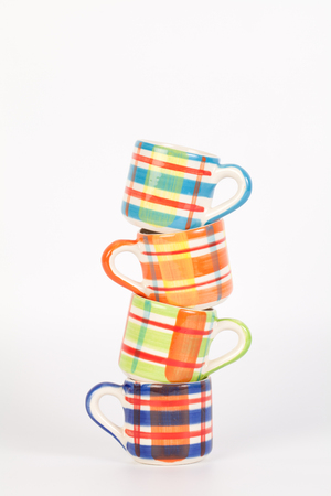 Tower of Colorful Scotch pattern cups Imagens